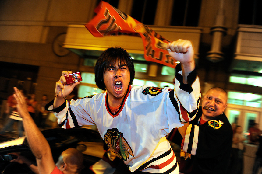 Jonathan Miano/Staff Photographer/Naperville.20100609   ..Chicago Blackhawks fans celebrate the Stanley Cup victory outside of the United Center Wednesday night..