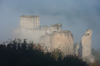 LES ANDELEYS, FRANCE - OCTOBER 10: View from the top of the embossed ramparts and the keep of the Chateau Gaillard in a fog, on October 10, 2008 in Les Andelys, Normandy, France. The chateau was built by Richard the Lionheart in 1196, came under French control in 1204 following a siege in 1203. It was later destroyed by Henry IV in 1603 and classified as Monuments Historiques in 1852. (Photo by Manuel Cohen)