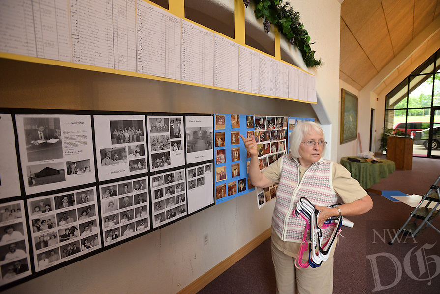 NWA Democrat-Gazette/BEN GOFF @NWABENGOFF<br /> Linda Andersen talks about photos on display on Friday May 20, 2016 while decorating in celebration the 130th anniversary of Springdale Adventist Fellowship.