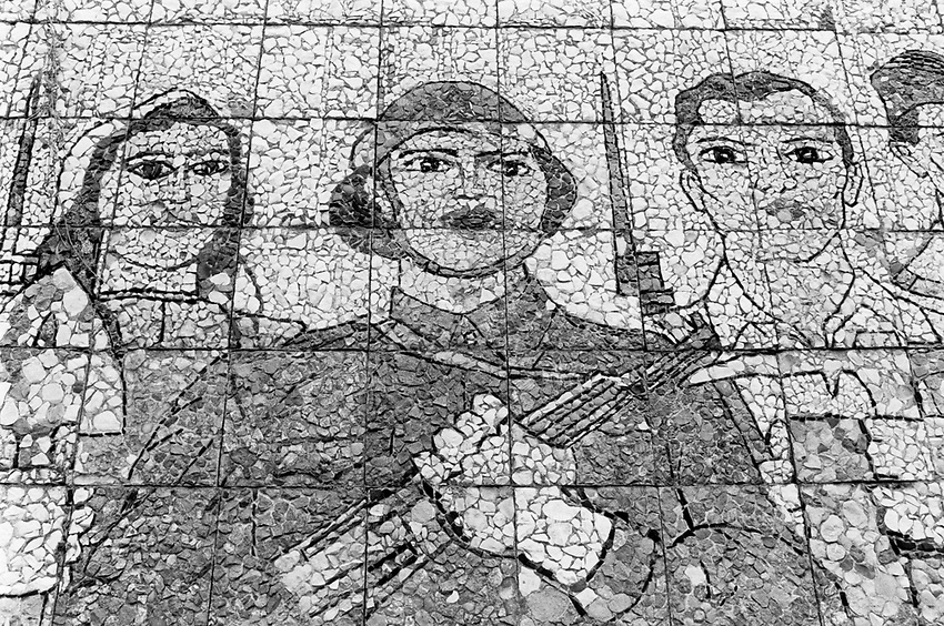 Wall painting on stones old symbols from the realism socialist time