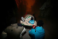 Sondre Ringen is carried on a stretcher to a nearby road after breaking his leg. Ski jumping in Schrøderbakken, a small ski jump in the forest near the more famous Holmenkollen.