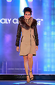 A female  model wearing a winter coat  with fur accents by Sicily Clothing at  the Moda sotto le Stelle fashion show held in little Italy in Montreal