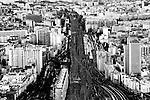 The photograph of railroad tracks and infrastructure from Paris via birds eye view.