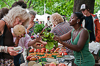 Selecting local foods at the farmers' market by Laura Berman- GreenFuse Photos.