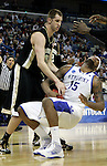 Freshman forward DeMarcus Cousins gets fouled by Chas MacFarland during the second half of UK's second round  win, 90-60 over Wake Forest in the NCAA tournament at New Orleans Arena on Saturday, March 20, 2010. Photo by Britney McIntosh | Staff