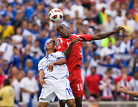 Luis Tejada (18) of Panama goes up for a header with Reynaldo Hernandez (19) of El Salvador  during the game at RFK Stadium in Washington, DC.  Panama defeated El Salvador on penalty kicks, 5-3, after tying, 1-1,  in regulation time.