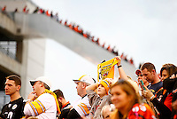 A Pittsburgh Steelers fan holds up a 'Terrible Towel' as Cincinnati Bengals leave along the escalator in the fourth quarter during the game at Paul Brown Stadium on December 12, 2015 in Cincinnati, Ohio. (Photo by Jared Wickerham/DKPittsburghSports)