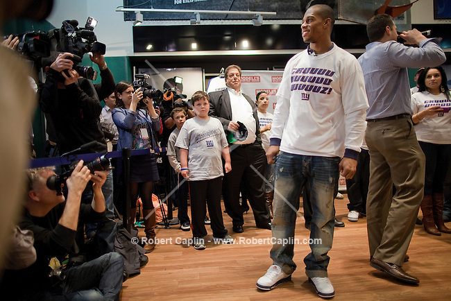 The New York Giant's Victor Cruz hosting the first ever in-store Salsa dance lesson at the Flagship Modell&rsquo;s Times Square store...Photo by Robert Caplin...
