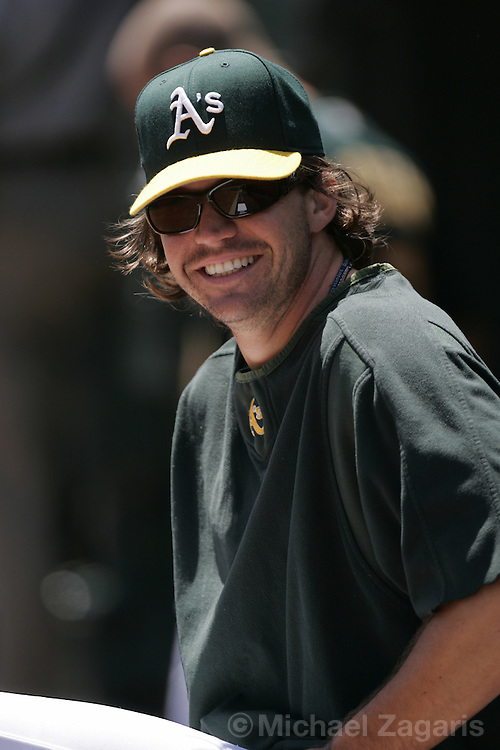 OAKLAND, CA - JULY 27:  Barry Zito of the Oakland Athletics looks on during the game against the Cleveland Indians at McAfee Coliseum on July 27, 2005 in Oakland, California. The A's defeated the Indians 5-4. (Photo by Michael Zagaris /MLB Photos via Getty Images)