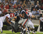 Ole Miss running back Brandon Bolden (34) is tackled by Fresno State's Chris Carter (43)  at Vaught-Hemingway Stadium in Oxford, Miss. on Saturday, September 25, 2010. Ole Miss won 55-38 over Fresno State. Lockett injured his ACL on the play and is out for the season.