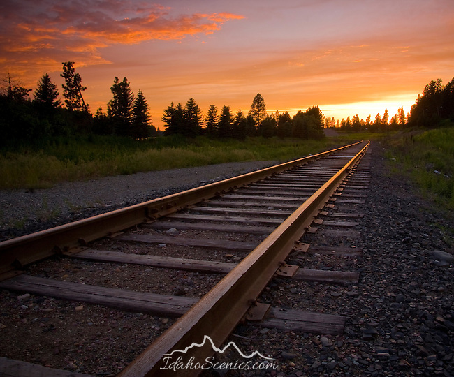 Idaho, North, Kootenai County, Coeur d'Alene. Railroad tracks lead into the sunset.