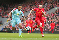 Burnley's Andre Gray chases under pressure from Liverpool's James Milner<br /> <br /> Photographer Rich Linley/CameraSport<br /> <br /> The Premier League - Liverpool v Burnley - Sunday 12 March 2017 - Anfield - Liverpool<br /> <br /> World Copyright &copy; 2017 CameraSport. All rights reserved. 43 Linden Ave. Countesthorpe. Leicester. England. LE8 5PG - Tel: +44 (0) 116 277 4147 - admin@camerasport.com - www.camerasport.com