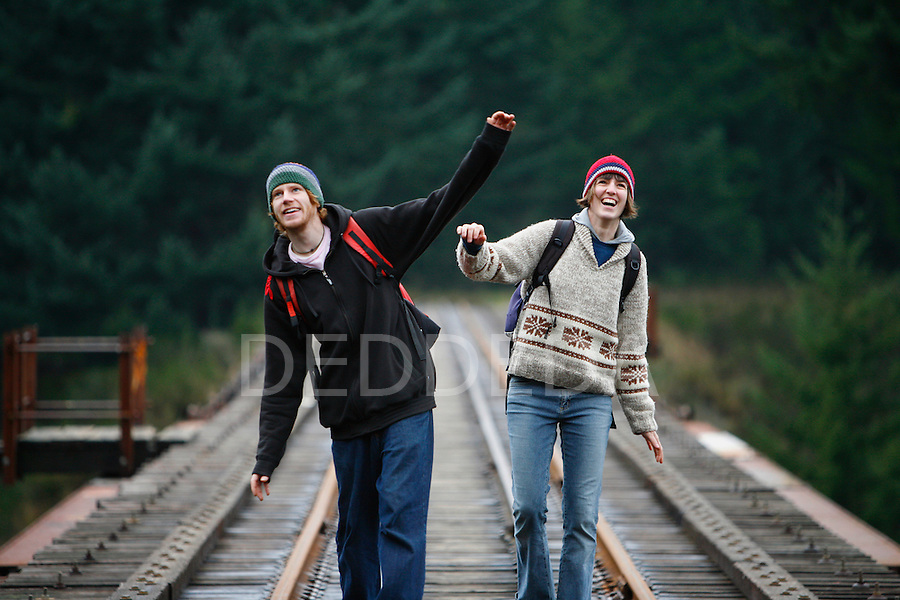 A young couple hiking in Goldstream Provincial Park, on beautiful Vancouver Island, near Victoria, British Columbia, Canada.