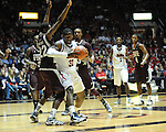 Ole Miss' Murphy Holloway (31) vs. Mississippi State's Brian Bryant (22) at the C.M. &quot;Tad&quot; Smith Coliseum in Oxford, Miss. on Wednesday, January 18, 2012. Mississippi won 75-68. (AP Photo/Oxford Eagle, Bruce Newman).