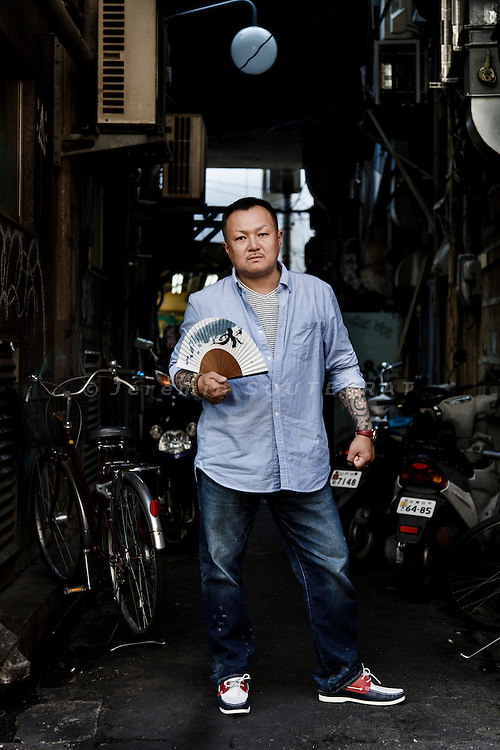 Tokyo, July 8 2014 - Portrait of Takayuki Niinuma, a former yakuza member turned into a NPO director after the tsunami hit the Tohoku region on March 11 2011. The Kizuna Project, through which Takayuki Niinuma operates, is the first Cabinet-approved NPO in Iwate Prefecture.