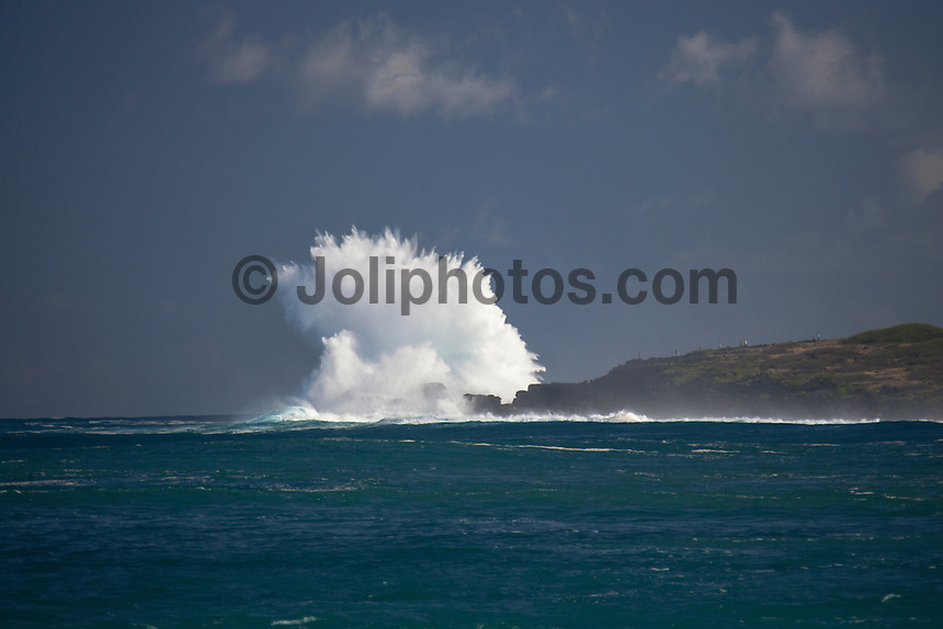 Waves breaking onto rocks at St Leu, Reunion Island. Photo: Joli
