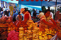 Young women working in a Mexican baked goods stand at the Friday market in Ocotlan, Oaxaca, Mexico