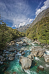 The flowing aqua blue waters of the Tutoko River near Milford Sound on the west coast of the south island of New Zealand.
