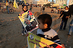 Palestinian children hold a pictures of Palestinian President Mahmoud Abbas during a rally in Gaza city on December 31, 2012. The Gaza branch of Palestinian president Mahmud Abbas's Fatah party said on Friday it will mark its anniversary in the Hamas-ruled enclave after an accord between the two factions. Photo by Majdi Fathi