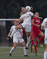 Boston College forward/midfielder Kate McCarthy (21) battles for head ball. After 2 complete overtime periods, Boston College tied Boston University, 1-1, after 2 overtime periods at Newton Soccer Field, August 19, 2011.