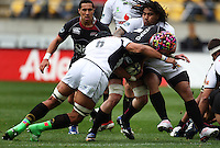 Wellington's Victor Vito and Ma'a Nonu tackle James King during the Air NZ Cup match between Wellington Lions and North Harbour at Westpac Stadium, Wellington, New Zealand on Saturday 17 October 2009. Photo: Dave Lintott / lintottphoto.co.nz.