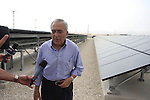 Palestinian Prime Minister Salam Fayyad speaks to the press during a visit to the solar power station in the West Bank city of Jericho on September 30, 2012. Photo by Issam Rimawi
