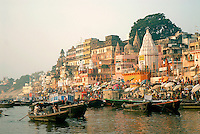 The first light of the rising sun revealed the domes, minarets, temples and nearly 90 ghats that identify the famous Varanasi skyline. For thousands of years, India's Hindu have been making the pilgrimage to Varanasi to be seen by the gods and to purify their souls in her holy waters.