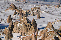 Goreme, Nevsehir, Cappadocia, Turkey.  With a hot air balloon of Kapadokya Balloons we glide over the valleys of Goreme National Park. A fresh pack of snow has turned the winter landscape into an even bigger fairy tale. Photo by Frits Meyst / MeystPhoto.com