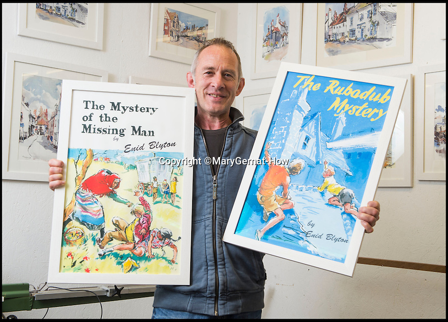 BNPS.co.uk (01202 558833)<br /> Pic: MaryGernat-How/BNPS<br /> <br /> ***Single Use - Not For Archive***<br /> <br /> Mary's son Roger with some of her Blyton artwork.<br /> <br /> The real family behind Enid Blyton's iconic book covers has been revealed for the first time thanks to a hidden archive of sketches and family photos.<br /> <br /> Mary Gernat, who created the paperback covers for about 100 children's books in the 1960s, would get her young sons to stop mid-play and pose for her while she quickly sketched ideas for books like The Famous Five, the Secret Series, St Clare's and Malory Towers.<br /> <br /> Her son Roger How, 58, has now unveiled some of his mother's never-seen-before original sketches and finished book drafts which capture the classic images of childhood adventure he and his brothers helped create.
