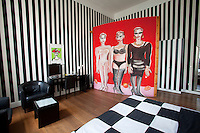 A room in the Arte Luise Kunst Hotel in former East Berlin. When the Wall came down the dilapidated building was turned into a pension for artists looking for cheap accommodation in the East. During the 90s, after much restoration, it became a hotel with each room designed by different artists, who no longer live there but who receive a percentage of the revenue from their rooms. It is now marketed as &quot;an art gallery you can spend the night in.&quot; The art in this room is by artist Elvira Bach..