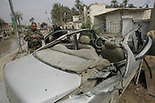 BAQUBA, IRAQ:  A damaged car after a series of bombings in the Iraqi city of Baquba...Three bombs went off in Baquba, the capital of Diyala Province, killing at least 30 people.  The first two bombs were at 9: 30 in the morning.  The third bomb was at a local hospital where the victims were being taken...Photo by Metrography.