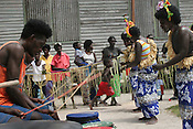 """school closing"" festivities and life on Han Island, Carterets Atoll, Papua New Guinea, on Monday, Dec. 11, 2006.Rising sea levels have eroded much of the coastlines of the low lying Carteret islands (situated 80km from Bougainville island, in the South Pacific), and waves have crashed over the islands flooding and destroying what little crop gardens the islanders have. Food is in short supply, banana and swamp taro crops are failing due to the salt contamination of the land, and the islanders live on a meagre one meal per day diet of fish and coconut. There is talk by the Autonomous Region of Bougainville government to relocate the Carteret Islanders to Bougainville island, but this plan is stalled due to a lack of finances, resources, land and coordination."