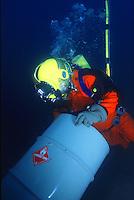Commercial diver (deep sea diver) recovering toxic waste drum.Santa Barbara, CA.