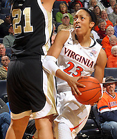 Feb. 3, 2011; Charlottesville, VA, USA; Virginia Cavaliers guard Ataira Franklin (23) tries to get around Wake Forest Demon Deacons forward Sandra Garcia (21) during the game at the John Paul Jones Arena. Virginia won 73-46. Mandatory Credit: Andrew Shurtleff