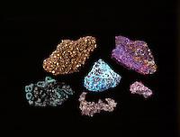COLORFUL ORES OF COPPER<br /> (clockwise from bottom left) Malachite; Chalcopyrite; Bornite; Chalcocite; Native Copper &amp; Chrysocolla (center)