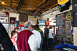 Saw's Soul Kitchen in Birmingham, Alabama's Avondale neighborhood serves up soul food like pork and greens with cheese grits.  Pictured here is the packed interior.