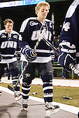 Connor Hardowa (UNH - 2), Damon Kipp (UNH - 4) - The University of Maine Black Bears defeated the University of New Hampshire Wildcats 5-4 in overtime on Saturday, January 7, 2012, at Fenway Park in Boston, Massachusetts.
