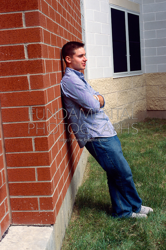 NEWTON'S THIRD LAW<br /> A Young Man Leaning Against A Wall<br /> The third law states that for every force there is an equal and opposite force. If one pushes a wall, the wall will push back with equal force.