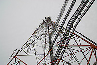 The gantries carry cables from the engineering building alongside, to the microwave antennae on the mast.