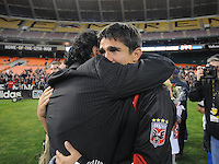 DC United forward Jaime Moreno (99) with former player Marco Etcheverry at the end of the game.  Toronto FC. defeated DC United 3-2 at RFK Stadium, October 23, 2010.