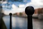 Metallic post by the Liffey river on Aston Quay, Dublin, Ireland