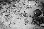 A recently deceased child awaits burial alone in an unmarked grave. Baardheere, Somalia. November 1992. .