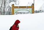 A woman walks past a sign for the Spring Valley area of Hirafu, Hokkaido in northern Japan on Feb. 7 2010. Niseko enjoys some 15 meters of snowfall per annum.