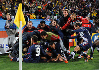 Michael Bradley of USA is piled on by team-mates after scoring the equaising goal. USA tied Slovenia 2-2 in the 2010 FIFA World Cup at Ellis Park in Johannesburg, South Africa on June 18th, 2010.