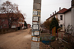 Traditional Serbian death notices on a street corner in Prahovo...Matt Lutton for the Financial Times