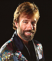 Chuck Norris, studio shoot, Los Angeles, 1983. Photo by John G. Zimmerman