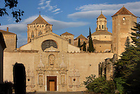 General view of the baroque facade, 16th century, entrance to the Cistercian Abbey of the Monestir de Poblet, 1151, Vimbodi, Catalonia, Spain, pictured on May 20, 2006 in the evening. The Monastery of Poblet belongs to the Cistercian Order and was founded by French monks. Originally, Cistercian architecture, like the rules of the order, was frugal. But continuous additions  including late Gothic and Baroque, eventually made Poblet one of the largest monasteries in Spain which was later used as a fortress and royal palace. It was closed in 1835 by the Spanish State but refounded in 1940 by Italian Cistercians. It is a UNESCO World Heritage Site. Picture by Manuel Cohen.