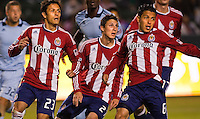 CD Chivas USA players (L to R) Marcos Mondaini (23), Benny Zemanski (21) and Francisco 'Ponchito' Mendoza (6) jockying for position on a cornerkick . Sporting KC defeated CD Chivas USA 3-2 at Home Depot Center stadium in Carson, California on Saturday March 19, 2011...