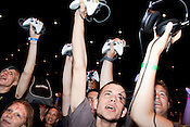 August 29, 2010. Raleigh, North Carolina.. Gamers celebrate the opening of competition. All competing players had to bring their own controllers to compete.. Major League Gaming (MLG), the league for professional videogame players, held their 50th Pro Circuit competition at the Raleigh Convention Center, with gamers from all over the country coming to for 3 days of competition in Halo 3, Tekken 6, Super Smash Bros. Brawl, Starcraft 2 and World of Warcraft.
