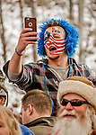 5 December 2015: An Erin Hamlin fan, with face painted in USA colors, takes photos with his cellphone, celebrating Erin's first place finish in the Viessmann World Cup Women's Luge at the Olympic Sports Track in Lake Placid, New York, USA. Mandatory Credit: Ed Wolfstein Photo *** RAW (NEF) Image File Available ***